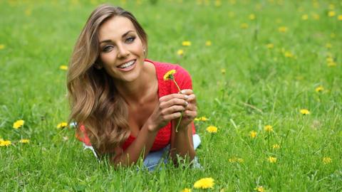 Woman smell dandelion Live Action