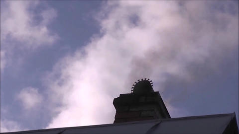smoke from the chimney on the roof Footage