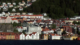 Norway City of Bergen 123 vehicle shot of town; Floyen and Ulriken mountains Footage