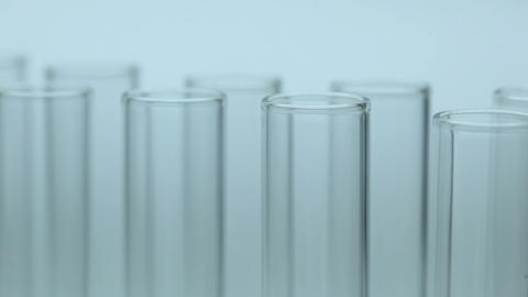 Liquid dripping from pipette into test tube Footage