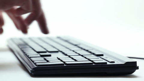 Hand typing on keyboard Live Action