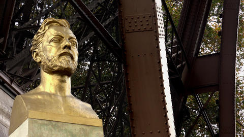 Monument (bust) Alexander Gustave Eiffel at the Eiffel Tower in Paris. 4K Footage