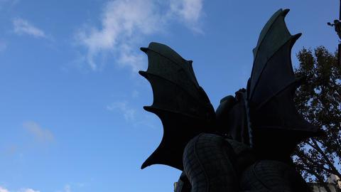 Demon wings against the blue sky. 4K Footage