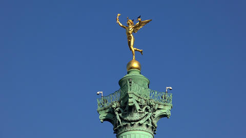 Colonne de Juillet on the place de la Bastille in Paris. Golden statue. France.  Footage
