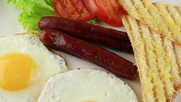 breakfast with fried eggs, sausages, toasts and tomatoes (loop) Footage