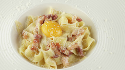 pasta carbonara with parmesan, egg yolk and bacon Footage