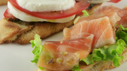 bruschetta with tomato, mozzarella and salmon, closeup Footage