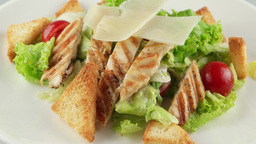 Caesar salad with grilled chicken, cherry tomatoes, croutons Footage