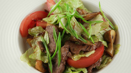warm salad with veal and roasted mushrooms Footage