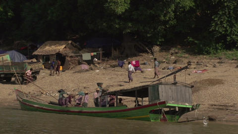 Boating on the Aye Yarwaddy river, people working at the shore side Footage