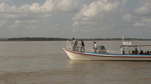 Boating on the Aye Yarwaddy river, boat with tourist passing by Live Action