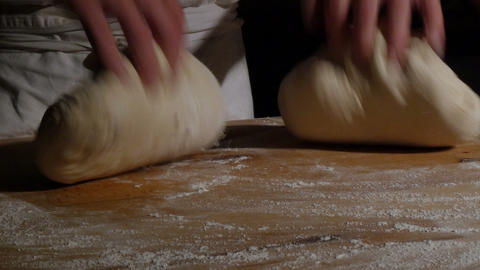 two german baker kneading bread dough spotlight dolly 11737 Footage
