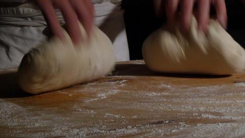 two german baker kneading bread dough spotlight dolly 11737 Footage