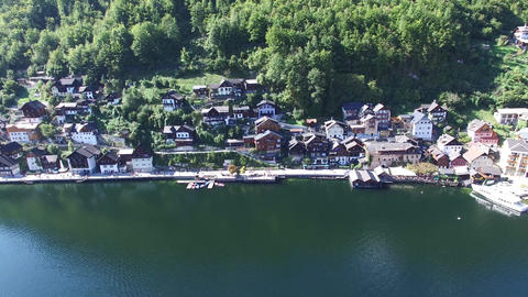 Famous Hallstatt mountain village and alpine lake, Austrian Alps, blue lake in s Footage
