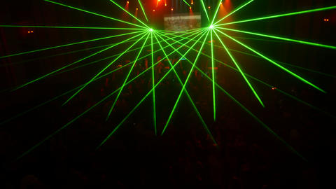 Green sparlking beams from laser show in crowded nightclub Footage