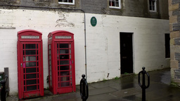 Scotland Orkney Islands Kirkwall 002 two original red British telephone boxes Footage