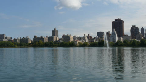 New York City Central Park fountain and urban Manhattan skyline with skyscrapers Footage