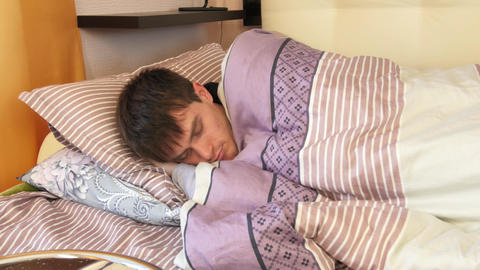 Close-up shot of young man in bed at home sleeping Footage