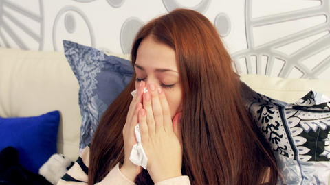 Sick woman in bed coughing and blowing nose Footage