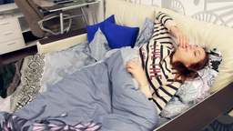Woman wake up with menstrual pain laying in bed Footage