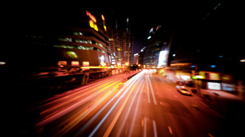Abstract blurred video of night city traffic across street. Time lapse. Hong Kon Footage