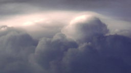 Storms Clouds with Sun Reflecting off the Top of Some Clouds Footage