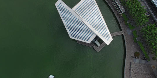 descending birds eye over louis vutton marina bay Footage