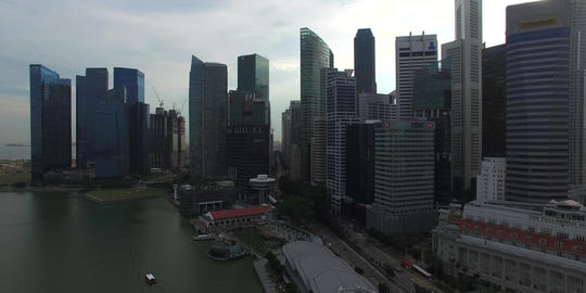 aerial in front of Singapore high rises Footage