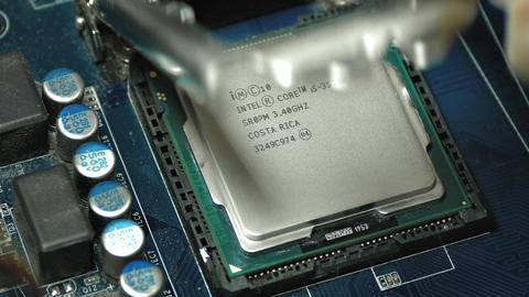 4K Installing Intel I5 CPU Into Motherboard Socket Footage