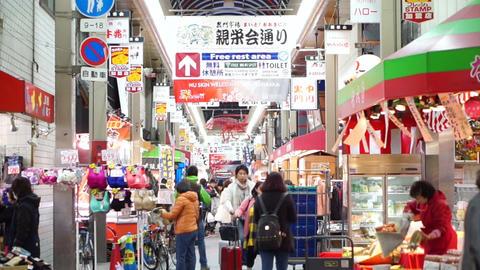 OSAKA, JAPAN - MARCH 2015: - Kuromon fish market in Osaka, Japan. Tourists walki Live Action
