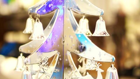 Christmas time silver ornament, tree, reindeer and bell hanging on a tree Footage