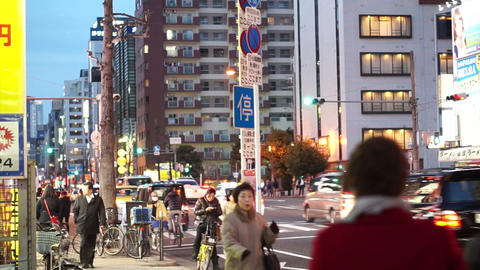 Osaka, Japan - March 2015 -People walking at evening along street in Osaka Footage