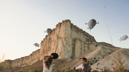 couple looking at blimps zeppelins Footage