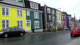 Canada Newfoundland St. John's 032 colorful houses in wet residential street Footage