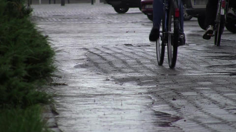 Cyclists in the rain 01 Footage