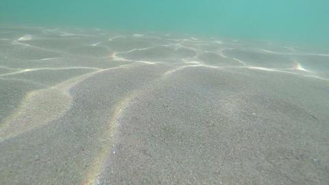 Sunbeams on sand under water Footage