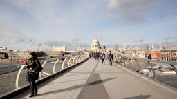 People walk over Millenium Bridge Six Footage