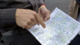 Person Explaining Helicopter Flight On Map Converted stock footage