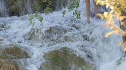 person walking up waterfalls Footage