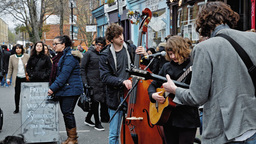 street musicians and spectators at flower market on columbia road Live Action