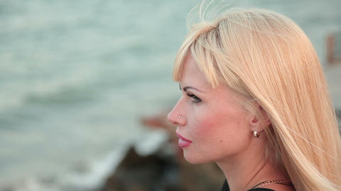 portrait of a woman in profile against the sea Live Action