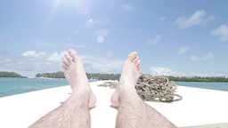 Tourist Legs On Boat Relaxing stock footage