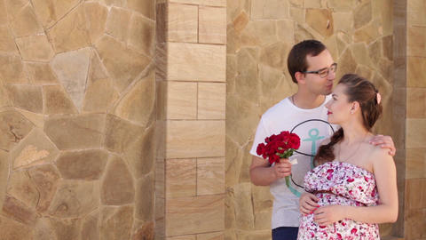 Pregnant wife and her husband on a walk_a man gives flowers Footage