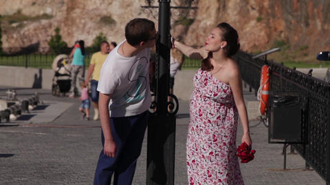 Young hipster beautiful couple in love kissing outdoor in summer on the street Footage