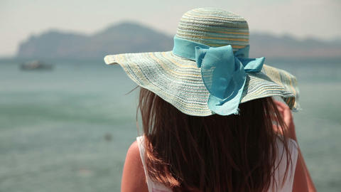 Woman in hat looking at sea Footage