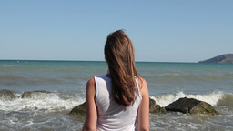 woman stands alone on the seashore Footage