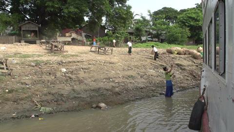 Ayeyarwady river, local woman sells bananas along the river Live Action