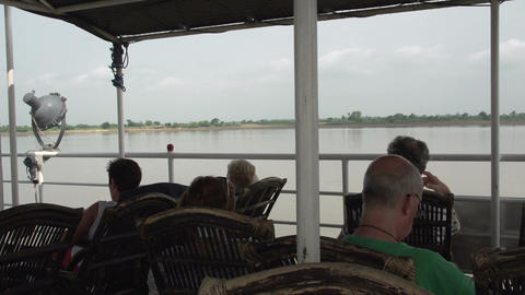 Ayeyarwady River, Tourists Relaxing On Deck Of Cruise Ship stock footage