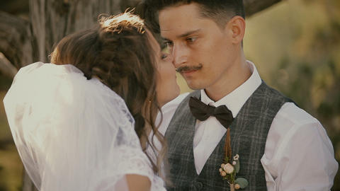 Portrait of bride and groom just married looking at each other Footage