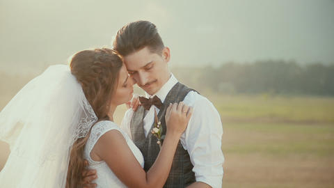 2663 bride and groom embracing each other on a walk in the countryside Footage